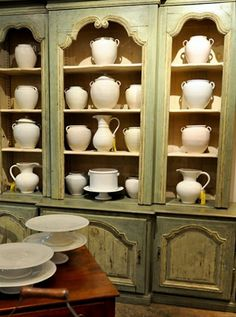 Green cabinets white pottery...