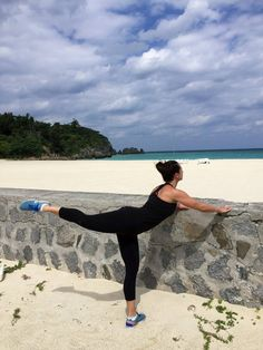 Elissa, owner of The Bar Method Phoenix (coming soon!) does arabesque while visiting the gorgeous beaches of Okinawa, Japan. #WhereDoYouBar?