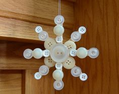 Things Needed for the Button Snowflake    •3 or 4 wooden craft sticks (popsicle sticks)   •various white, silver, gold, or cream colored buttons, in various sizes   •craft glue of your choice