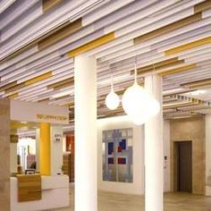 Baffle ceiling by lindner group stylepark Ceiling Decor, Ceiling Design, Wall Design, Ceiling Lights, Ceiling Ideas, Baffle Ceiling, Metal Ceiling, Building Renovation, Store Windows