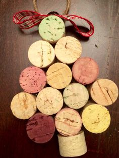 This handmade ornament is made out of recycled wine corks. Each Christmas Tree ornament contains 13 wine cork halves, which are lightly painted in