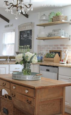 White Cottage Farmhouse Kitchen, featuring vintage antique island - Gracie Blue at foxhollowcottage.com