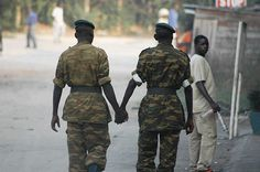 Soldiers Holding Hands It is not unusual in many societies throughout east Africa for men to display their friendship for one another by holding hands in public. Two soldiers on patrol in the streets of Bujumbura, Burundi non-chalantly express their affection for one another.