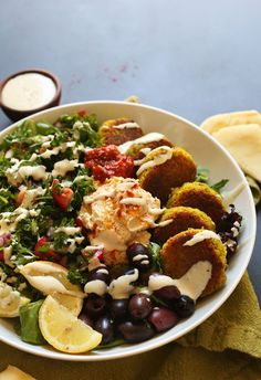 Mediterranean Bowl with hummus, falafel, tahini sauce, olives, and pita! #vegan