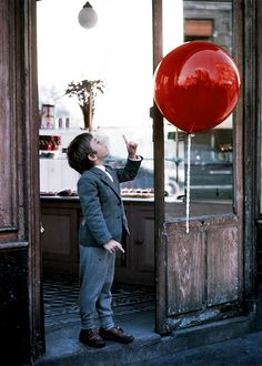 The Red Balloon saw it on seventies childrens prog picture box when i was little(they knew how to educate us through telly in those days) poignant,beautiful touching,sad never forgot it seen it many times since always has an impact