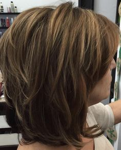 Medium layered hairstyle with bangs is youthful and creates volume. Photo credit- therighthairstyles.com