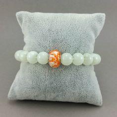 Bransoletka biala szklana pomarańczowy koralik modułowy