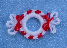 If you love crochet projects and Christmas ornament crafts, then we have the perfect to-do for you. Make this Crochet Wreath Ornament. This crochet ornament pattern is the perfect little ornament for any Christmas tree. Crochet Christmas Decorations, Christmas Crochet Patterns, Holiday Crochet, Christmas Ornament Crafts, Christmas Projects, Holiday Crafts, Handmade Christmas, Christmas Tree, Christmas Goodies