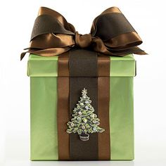This box is just the right size for homemade cookies in cellophane bags and perfect to reuse as storage for keepsakes. Personalize the box with layered ribbons, bows, and holiday cutouts (like this Christmas tree).