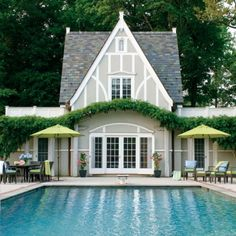 How can we fix the addition and pool house to flow with the main home? Pool house with Tudor style --stucco base color and trim lighter