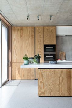 Love the use of wooden in this sleek modern kitchen design. Home Decor Kitchen, Kitchen Furniture, Kitchen Interior, New Kitchen, Home Kitchens, Kitchen Dining, Furniture Stores, Furniture Websites, Furniture Companies