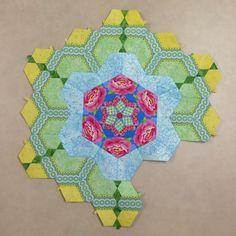 Katja Marek's The New Hexagon - Millefiore Quilt-Along: Rosette 3: Round 2 done. By Tracy Pierceall, 3/11/2015