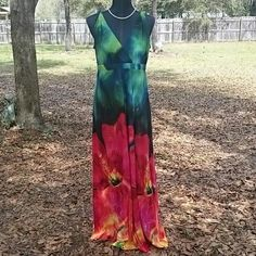 Colorful long dress by Ronnie Nicole Beautiful vibrant colors in this long dress by Ronnie Nicole. Polyester and spandex mix. V-neck, rolled straps.  Gorgeous summer dress. Perfect for a cruise, out to dinner, even a wedding or party. Ronnie nicole Dresses Maxi