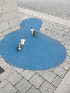 Bill and Bob swimming in a puddle in Millennium Square in Bristol, UK.
