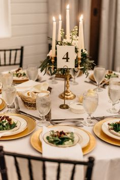 Simple and classic centerpiece ideas--candelabra with greenery and flowers