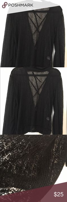 LIGHTWEIGHT BLACK SWEATER TIES IN BACK Gorgeous lightweight black sweater somewhat see through I would recommend a dark bra so u don't take away from the ties in the back of the sweater it has a small collar bell sleeves. These r too cute on my girlfriends bought most I had to reorder for my closet Sweaters Cowl & Turtlenecks