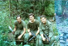 Soldiers of I Field Force, Vietnam bearing rather unique weapons. From left to right, a Bowie knife, M3 grease gun, M2 carbine.