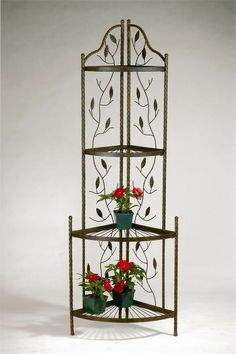 "Decorative wrought iron planter stand.Outstanding craftsmanship.Durable powder-coated finish.Beautiful vine and leaf detailing.Features four sturdy shelves.Protective hard rubber feet included.Assembly required.Free Standard Shipping!Dimensions: 69"" H x 23"" W x 16"" Deep. Price $179.99"