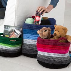 "Free Knitting Pattern for Ombre Baskets - Three sizes of striped baskets with optional handles. Large basket measures about 14"" [35.5 cm] tall, Medium about 10½"" [26.5 cm] tall, and Small about 7½"" [19 cm] tall. Designed by Heather Lodinsky for Red Heart."