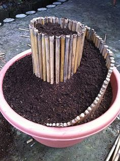 Mini Spiral Garden in a plant container - would look nice with succulents - could use craft sticks