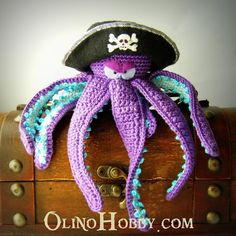 put eye patches and pirate hats on stuffed animals for decor like this Pirate octopus
