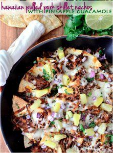 This slow cooker nacho recipe for Slow Cooker Hawaiian Pulled Pork Skillet Nachos with Pineapple Guacamole is as colorful as it is unique!