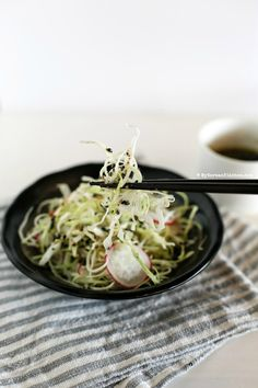 Sweet and Tangy Cabbage Salad - Cabbage and pink radishes served with sweet and tangy roasted sesame seed dressing. It's light, refreshing and crunchy!   MyKoreanKitchen.com