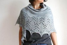 """Created in collaboration with the shop Les Petits Points Parisiens for CSF 2015With its wide lace pattern that is reminiscent of the Art Nouveau swirls, Folie Douceis a lightweight and enveloping shawl, perfect for Fall.The shawl is knitted from the top and down, starting with a simple and relaxing triangular section, in stocking stitch. The lace part placed on the second half of the project brings the essential touch of elegance, that makes all the differenceThe name """"Folie Douce"""" is a…"""
