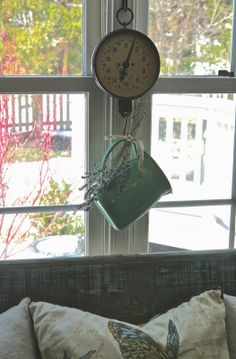 How cute is this pitcher hanging from an old scale!