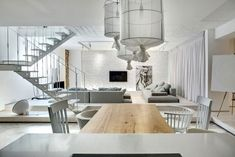 Almost All White Apartment in Kiev Plays With Materials and Textures - http://freshome.com/white-apartment-Kiev/