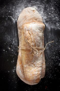 Bread Beautiful food styling. Cozy feeling with the breads huging each other with that line. Love the flour around