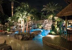 A lush landscape design and stunning swimming pool create a fun retreat for all ages Swimming Pool Designs, Swimming Pools, Mini Piscina, Tropical Backyard, Backyard Pools, Infinity Edge Pool, Luxury Pools, Beautiful Pools, Dream Pools