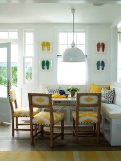 Phoebe Howard built in kitchen #banquette. #Yellow upholstered chairs.