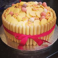 White chocolate cake - Victoria sponge, white chocolate buttons, jazzies, mini eggs. Easy to make but looks amazing!