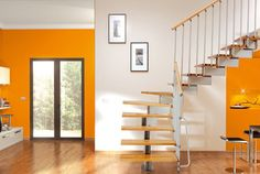 The Stilo Open Staircase with Light Beech Treads and handrail & Grey Steel central spine.  The modular format is available as a straight stair or an L-shape or U-shape.
