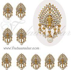Peacock design white stone jewellery set for the hair  http://www.vadaamalar.com/jadai-billai-set-5631.html