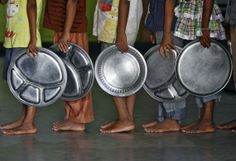 Children holding plates wait in a queue to receive food at an orphanage run by a non-governmental organisation on World Hunger Day, in the southern Indian city of Chennai May 28, 2014. REUTERS/Babu