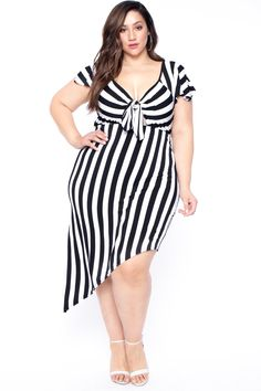 This plus size, stretch-knit striped dress features a V-neckline with self-tie detail, short sleeves, and an asymmetric hemline Content + Care Polyester & Spandex Hand Wash Cold Model Measurement Wearing a Size Height: Bust: Waist: Hip: Inseam: Trendy Plus Size Clothing, Plus Size Dresses, Plus Size Outfits, Plus Size Fashion, Curvy Outfits, Fashion Outfits, Plus Size Beauty, Curvy Women Fashion, Striped Dress