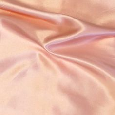 Charmeuse Satin is a light-weight fabric with a silk-like luster on one side and a matte, crepe-like finish on the other. This is a luxurious material with a delicate feel which makes it perfect for b