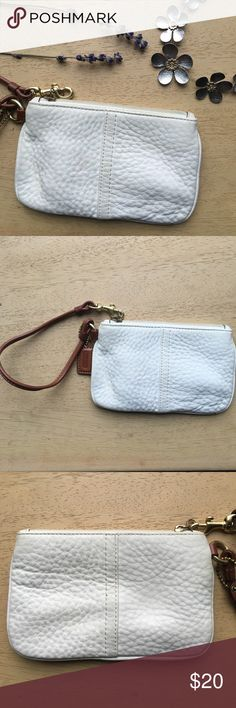 Coach White Pebbled Leather Wristlet This white Coach wristlet was given to me as a gift and I have never used it! It has been sitting unused since I received it, so it is in perfect condition. There are small bumps in the leather from storage. Interior is beige with no pockets or zips, & enough space for coins, cosmetics, or whatever you'd like! Coach Bags Clutches & Wristlets