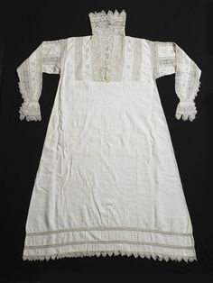 A woman's white linen smock decorated with intricate bands of geometric cutwork taken from another object, possibly a cover, and used as insertions on the sleeves, cuffs, collar and upper part of the front. If worn underneath an open-necked gown, the exquisite needlework would have been visible.  1603-10