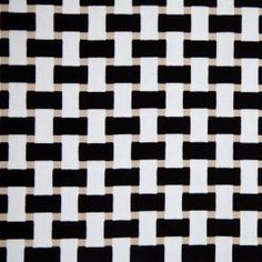 A cut-velvet upholstery fabric featuring inch-wide strips interwoven in a lattice-work pattern. Heavyweight and suitable for all kinds of upholstery projects.