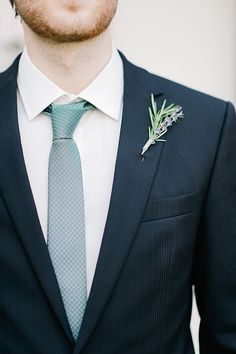 style | subtle pinstripe suit and lavender boutonniere | nadia meli photography | via: wedding party app