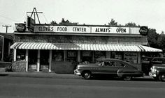 Cloyds Food Center in front there is a 1949 Buick, 1941 Chevrolet. Location West Grand