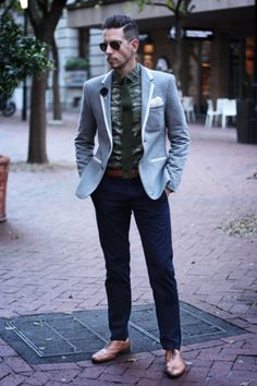 Great Style !!! Grey blazer with white trim, camp button down shirt, olive knit tie, hunters green tie clip, blue lapel flower, white pocket square, tan belt. blue skinny chinos, tan brogues.