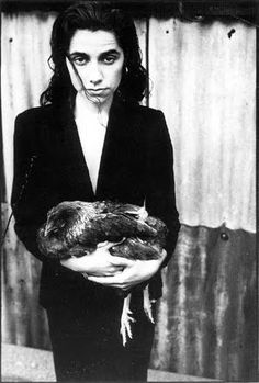 PJ Harvey-- i took a pic recently holding a chicken-- no way did i look this cool!!!