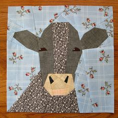 Cow Pattern.  Turned out really well and was lots of fun piecing it together.  I liked it better than regular quilting because I didn't have to be so perfectionist when cutting out the pieces.