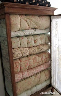 To make faux vintage linens soak your small print comforters in a large tub of a pot of coffee or tea until desired effect is achieved, practice on sham or other fabric 1st as the fabrics take color different but it's fun,