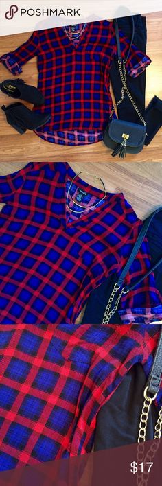 Red blue and black plaid tunic. Red blue and black plaid tunic. Perfect with leggings or jeans. Roll tab sleeves. Vneck front. Side pocket detail. Perfect for the upcoming season. Great condition. OPEN TO OFFERS! DISCOUNTS ON BUNDLES! Rue 21 Tops