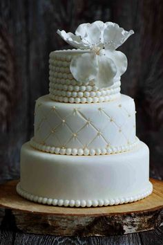 cream colored wedding cake with three tiers and quilted design with pearl rings Wedding Cake Base, Wedding Cake Pearls, Elegant Wedding Cakes, Beautiful Wedding Cakes, Gorgeous Cakes, Fondant Wedding Cakes, Wedding Cupcakes, Cake San Diego, Arts Bakery